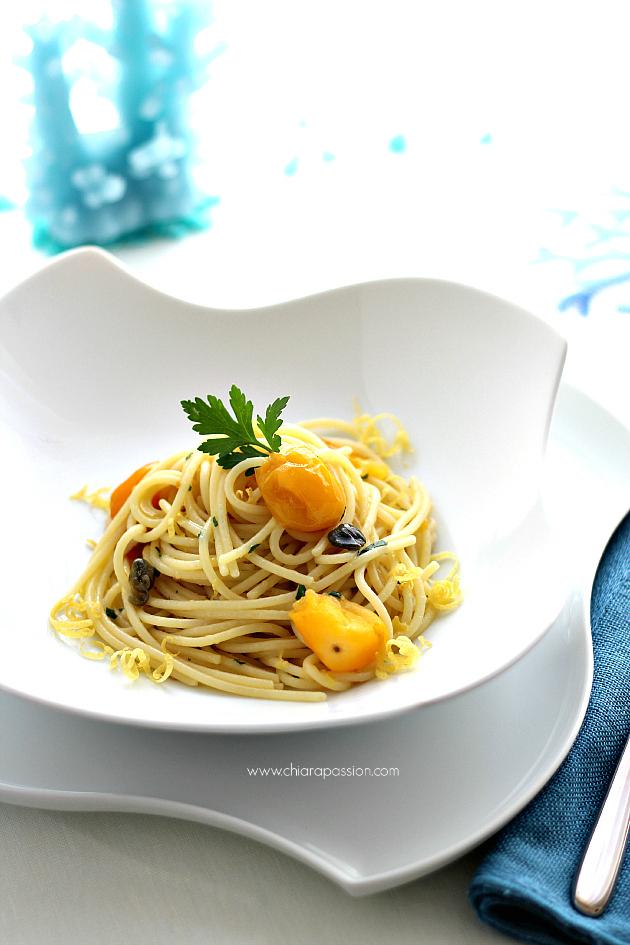 Spaghetti con pomodorini gialli,colatura di alici e zeste di limone
